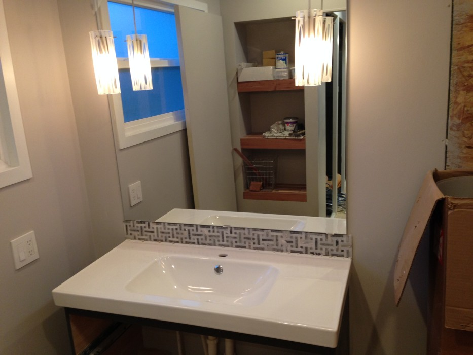 bathroom vanity pendant lights installed bathroom sink and mirror with mosaic tile back splash