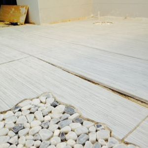 Bathroom Big Tiny House - Sloped floor transitions