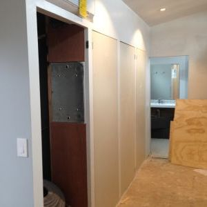Fitting wardrobe closet doors in place