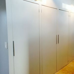 Wardrobe closet doors hung and handles installed