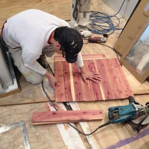 Cutting cedar paneling for washing area wall in closet