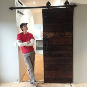 Finished custom living room barn door made from reclaimed wood