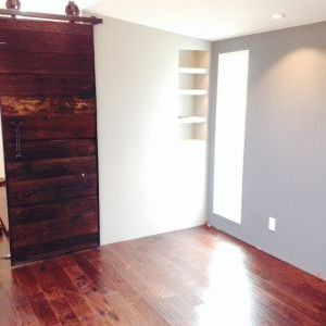 Living room hardwood floors and reclaimed barn door