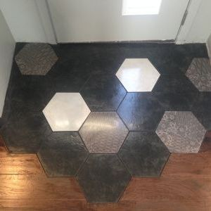 Finished entry way hexagonal tiles with wood floor cutaway