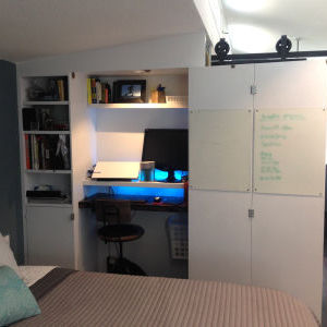 Bedroom office with bi-fold doors open and LED lighting