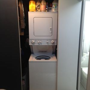 Stack washer and dryer in bedroom closet area